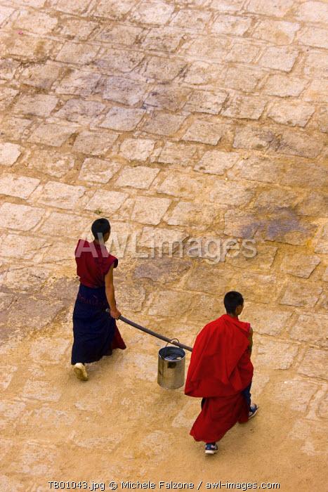 Monks carrying yak butter, Ganden Monastery, Tagtse county, Tibet