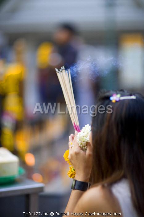 Praying at temple, Bangkok, Thailand