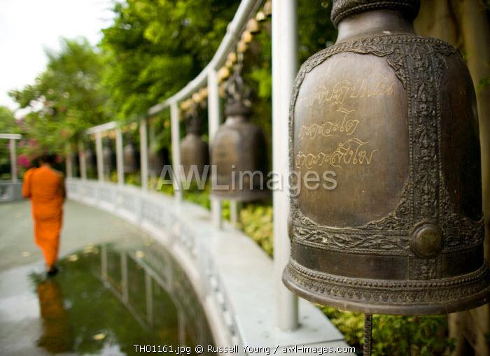 Monk and temple bells, Golden Mount, Wat Saket temple, Bangkok, Thailand