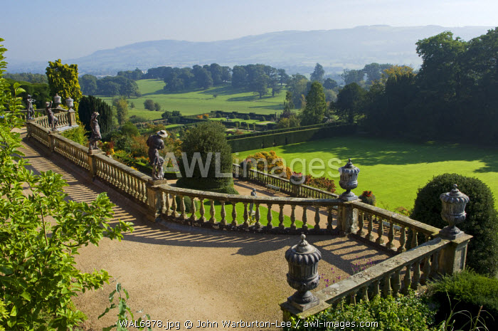 Wales; Powys; Welshpool.  View over the Aviary Terrace with its Italianate sculptures of shepherds and shepherdesses and ornate ballustrading at the spectacular garden at Powis Castle
