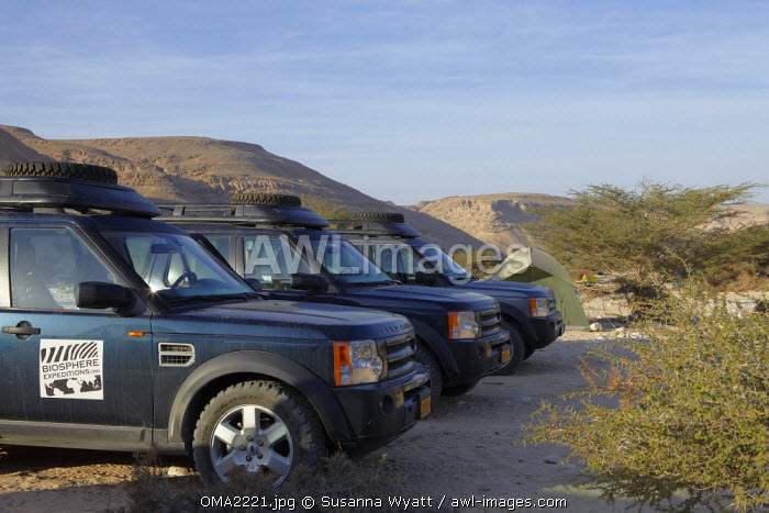 Oman, Dhofar. The Landrovers park up at base camp during the 2009 Biosphere Expedition surveying the Arabian leopard in the Wadi Uyun.