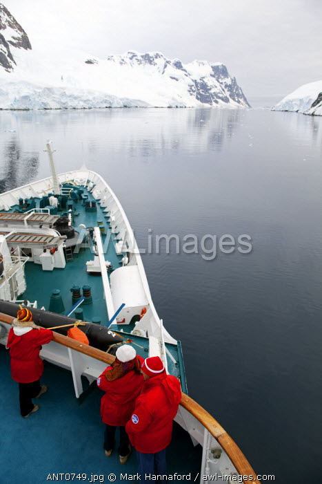 """Antarctica, Gerlache Strait.  Exploring the Lemaire Channel located between the Antarctic Peninsula (Graham Land) and Booth Island, sometimes known as """"Kodak Gap"""" it is one of the top tourist destinations in Antarctica"""