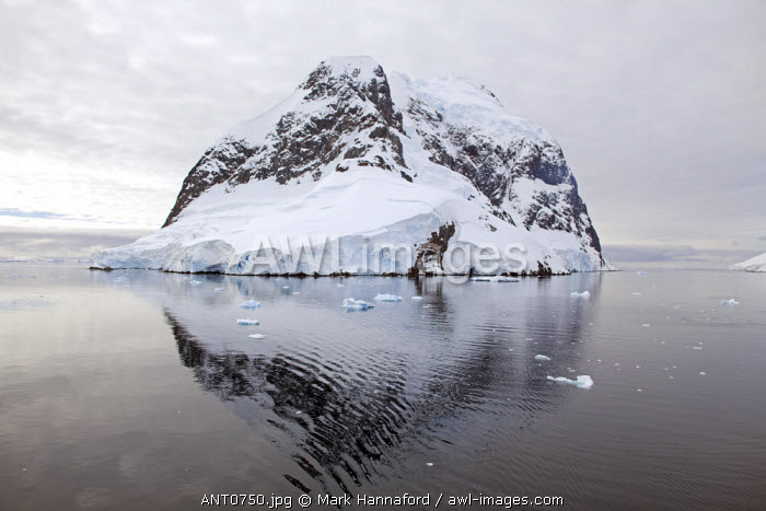 "Antarctica, Gerlache Strait.  Exploring the Lemaire Channel located between the Antarctic Peninsula (Graham Land) and Booth Island, sometimes known as ""Kodak Gap"" it is one of the top tourist destinations in Antarctica"