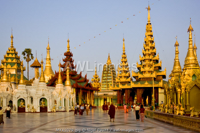 Myanmar, Burma, Yangon. The small stupas, temples, shrines, prayer halls and pavilions of the Shwedagon Golden Temple glow in the late afternoon light.