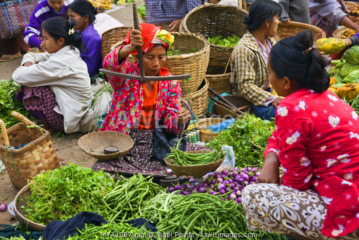 Myanmar. Burma. Nyaung U. A busy market scene with fresh fruit and vegetables at Nyaung U.  Local scales for weighing produce are commonly used.