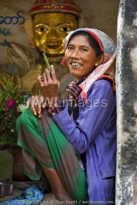 Myanmar. Burma. Bagan. A Burmese woman at the Tharaba Gate, the gates into the old city of Bagan which were built in 849 AD and renovated in the 11th century.