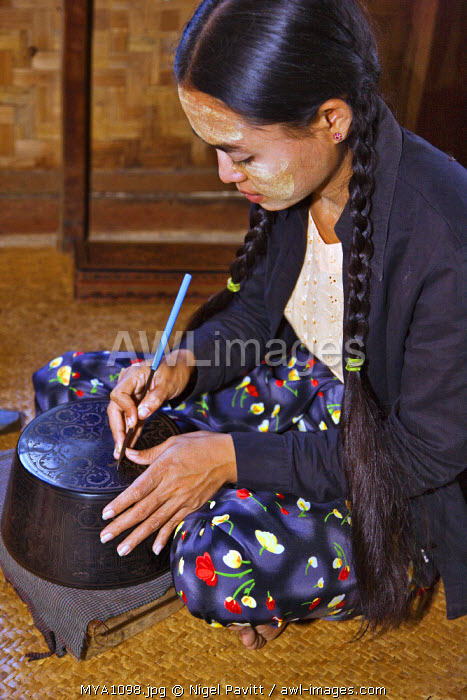 Myanmar. Burma. Bagan. A Burmese woman engraving a lacquer bowl at a lacquer workshop in Bagan.