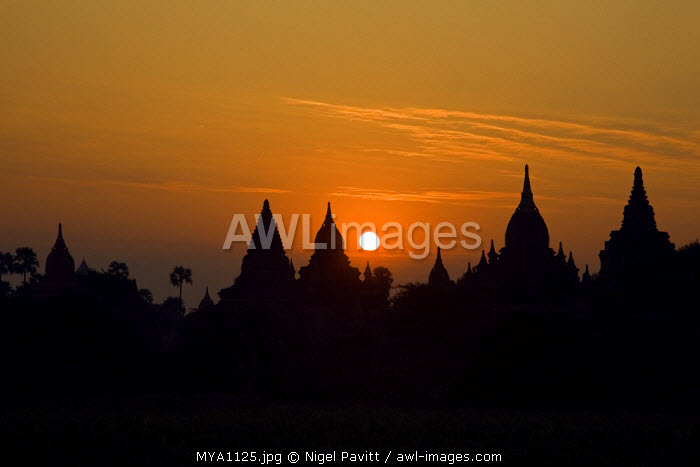 Myanmar. Burma. Bagan. Sunrise over ancient Buddhist temples on the central plain of Bagan. Founded in 1044, the Bagan dynasty built 2,229 temples in 200 years.