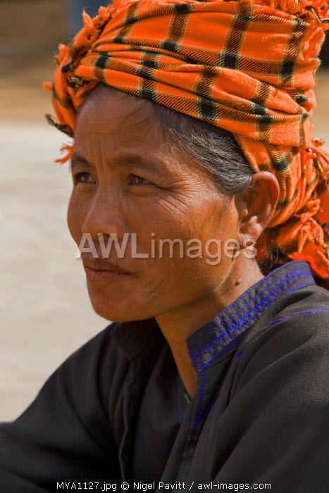 Myanmar. Burma. Pwehla. A Pa-O woman in typical attire. The Pa-O are also known as the dragon people because their layers of black clothing resemble the scales of a dragon.