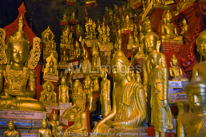 Myanmar. Burma. Pindaya. Some of the 8,000 golden statues of Buddha that are housed in the extensive limestone caves at Pindaya.
