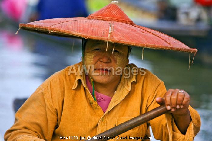 Myanmar. Burma. Lake Inle. A Burmese woman at the floating market of Ywa-ma on Lake Inle.