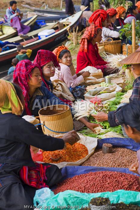 Myanmar. Burma. Lake Inle. Pa-O women selling farm produce at the floating market of Ywa-ma on Lake Inle.