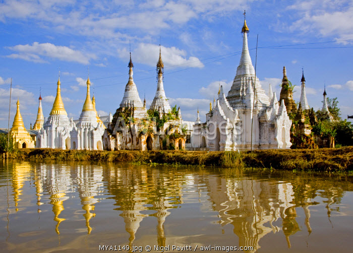 Myanmar, Burma, Lake Inle. Buddhist shrines reflected in the waters of Lake Inle.