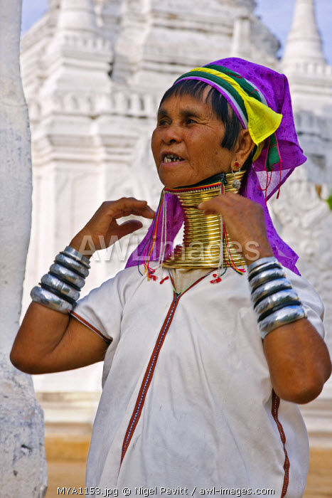 Myanmar, Burma, Lake Inle.  A Padaung woman belonging to the Karen sub-tribe wearing a traditional heavy brass necklace with twenty-five rings which elongates the neck.