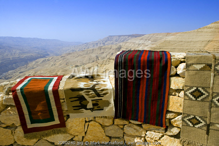 Jordan, Petra Region. A carpet stall over looks deep canyons lining the side of the Kings Highway leading from Amman to Petra
