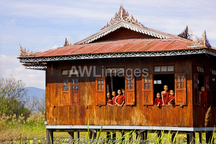 Myanmar, Burma, Lake Inle. Young novice monks at a monastery school on Lake Inle.  Much of the early education of young boys takes place in Buddhist monasteries.