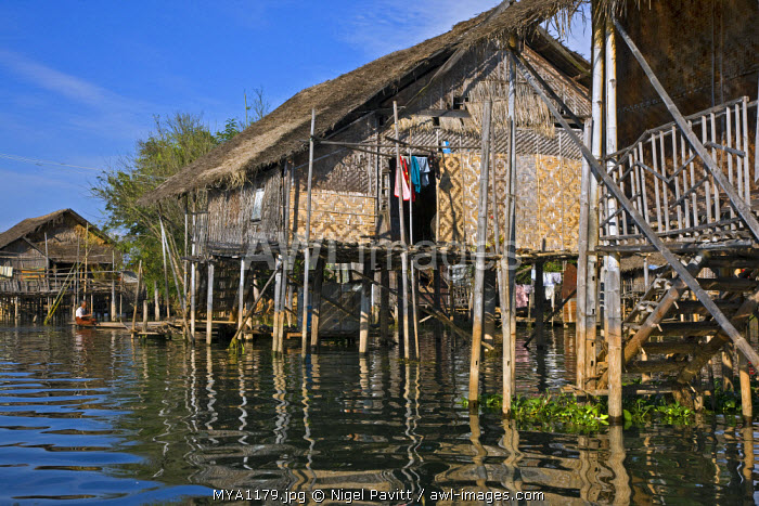 Myanmar, Burma, Lake Inle. Typical Intha houses on stilts in Lake Inle. The patterned walls are made of woven bamboo.