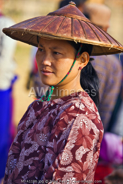 Myanmar, Burma, Lake Inle. A woman wearing a traditional wide-brimmed bamboo hat at Indein market.