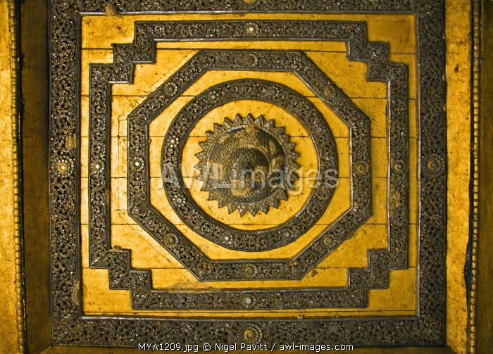 Myanmar. Burma. Nyaung-shwe. The finely decorated ceiling of the attractive wooden thein or ordination hall of the mid-19th century Shwe Yaunghwe monastery.
