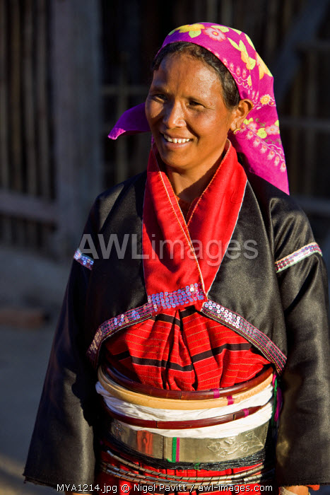 Myanmar. Burma. Wanpauk village. A Palaung woman of the Tibetan-Myanmar group of tribes displays her wealth by wearing broad silver belts. The poorer families use aluminium.