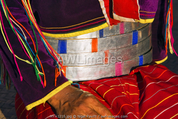 Myanmar. Burma. Wanpauk village. Palaung women of the Tibetan-Myanmar group of tribes display their wealth by wearing broad silver belts. The poorer families use aluminium.
