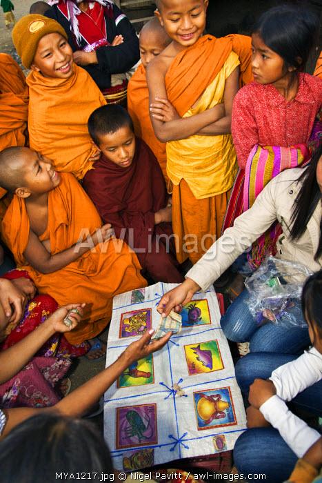 Myanmar. Burma. Wanpauk village. Street gambling at Wanpauk village.