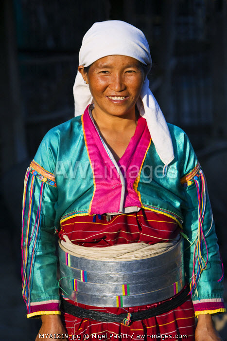 Myanmar. Burma. Wanpauk village. A Palaung woman of the Tibetan-Myanmar group of tribes. Women commonly display their wealth by wearing broad silver belts.