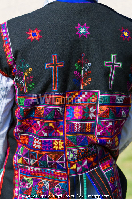 awl-images.com - Myanmar / Myanmar, Burma, Kengtung. The beautiful embroidery on an Akha man's jacket with crosses that denote he is a Christian.