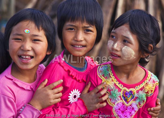 Myanmar, Burma, Namu-op. Happy Akha children in brightly coloured jumpers.