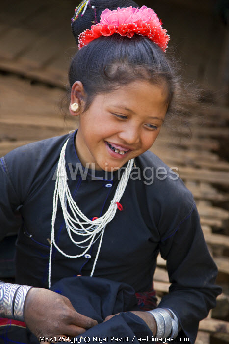 Myanmar, Burma, Pan-lo. A woman of the small Ann tribe in traditional attire with blackened teeth. The Ann blacken their teeth to ward off evil spirits.