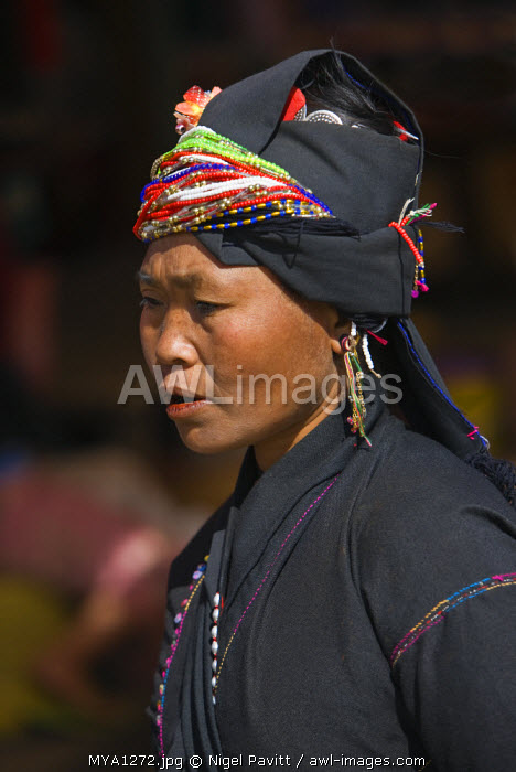 Myanmar, Burma, Pan-lo. A woman of the small Ann tribe in Kengtung market. The Ann blacken their teeth to ward off evil spirits.