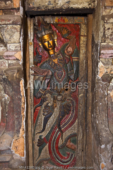 Myanmar, Burma, Wun nyat. An original carved and decorated doors of the beautiful Wun nyat monastery, first built in the 15th century but later renovated and extended.
