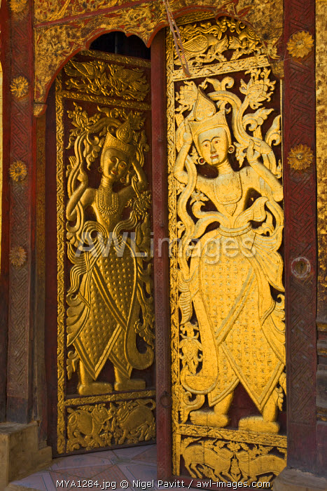 Myanmar, Burma, Wan-seeing. The ornately carved and gilded doors of the beautiful 15th or 16th century Wan-seeing monastery.