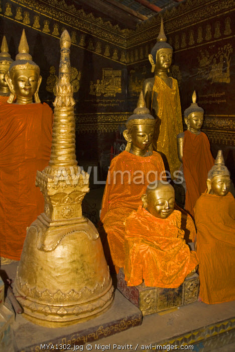Myanmar, Burma, Kengtung.  Statues of Buddha in the Wat In monastery at Kengtung. Chinese influence is evident from the Buddhas' eyes.