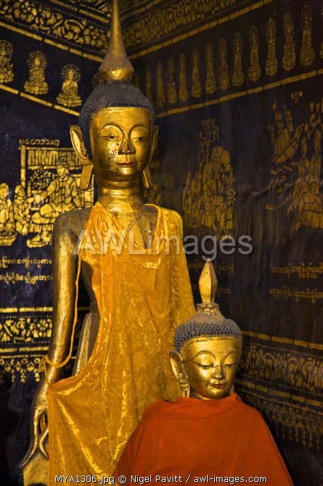 Myanmar, Burma, Kengtung. Two ancient wooden statues of Buddha in the Wat In monastery at Kengtung, possibly dating back to the 9th or 10th centuries.
