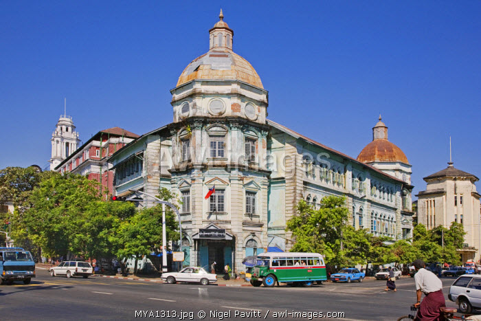 Myanmar, Burma, Yangon. The faded splendour of grand buildings in Yangon denotes the country's colonial past under British rule.
