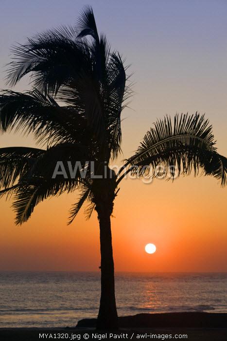 Myanmar, Burma, Rakhine State. sunset over the Bay of Bengal at Sittwe.