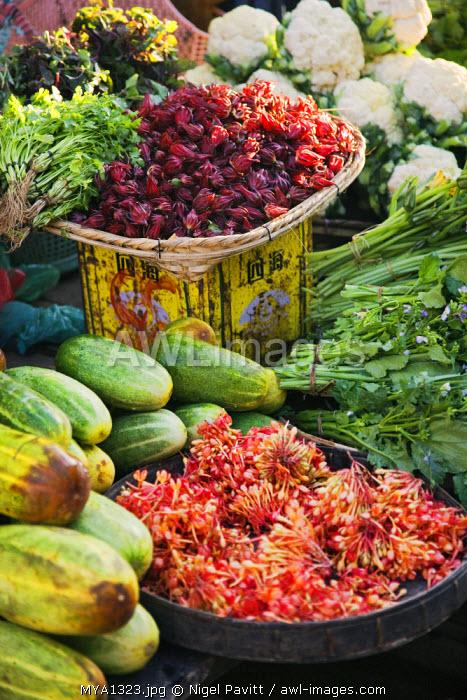 Myanmar, Burma, Rakhine State. A stall at Sittwe's bustling market displaying an impressive selection of fresh produce.