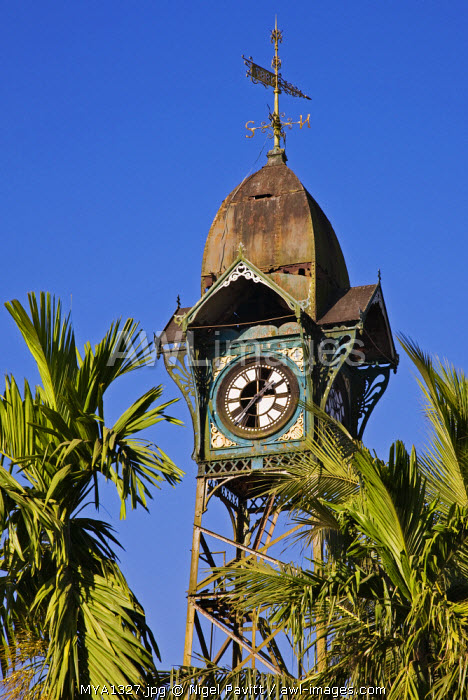 Myanmar, Burma, Rakhine State. The old clock tower at Sittwe, complete with weather vane, was erected by the Dutch on a steel structure in the eighteenth century.
