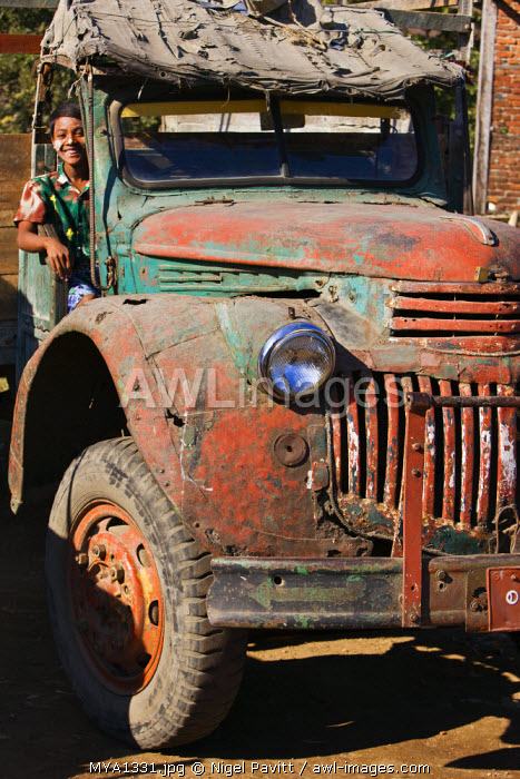 Myanmar, Burma, Sittwe. Old military vehicles like this Chevrolet lorry were abandoned as scrap in Burma after World War II but are still going strong sixty years later.