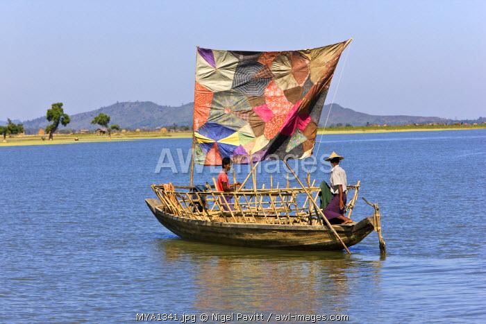 Myanmar, Burma, Kaladan River. A traditional sailing boat on the Kaladan River.