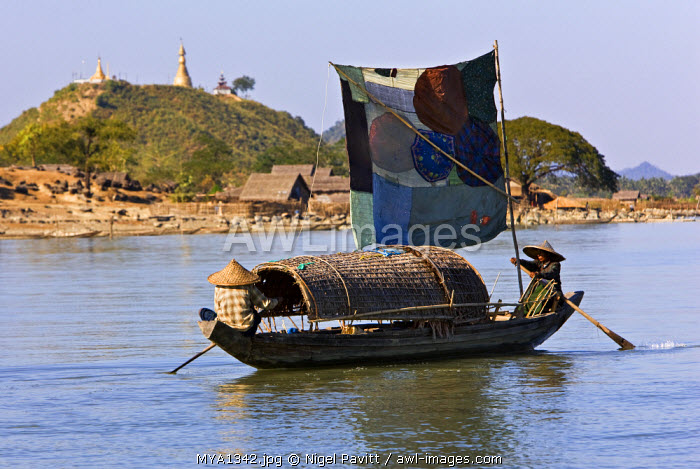 Myanmar, Burma, Kaladan River. A traditional sailing boat on the Kaladan River.