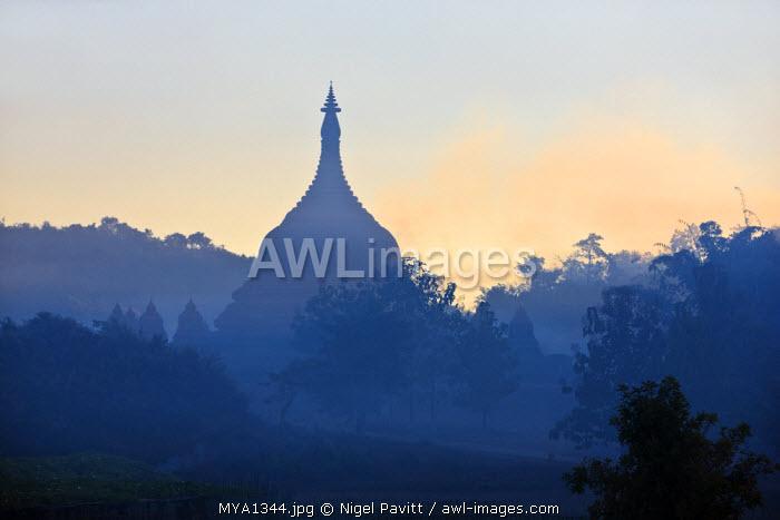 Myanmar, Burma, Mrauk U. Dawn mist shrouds the ancient temples, payas and stupas of Mrauk U.