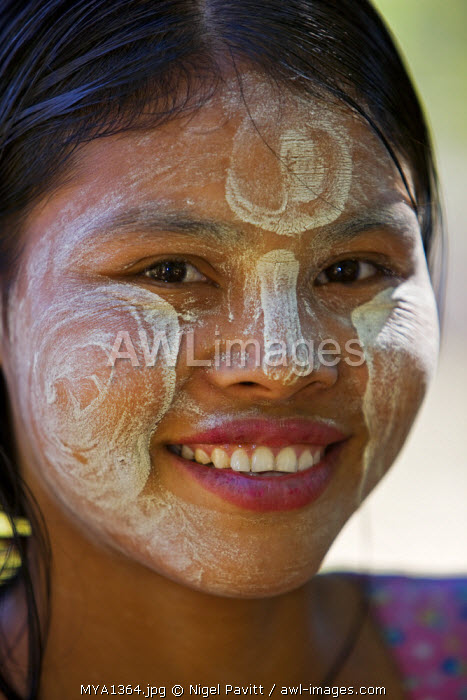 awl-images.com - Myanmar / Myanmar, Burma, Mrauk U. A pretty young girl of the Rakhine ethnic group with her face decorated with Thanakha, a popular local sun cream and skin lotion.