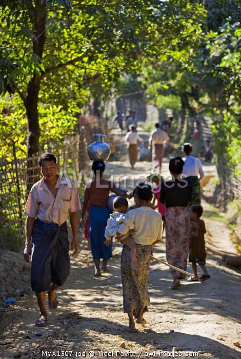 Myanmar, Burma, Mrauk U. A busy thoroughfare in a village near Mrauk U.