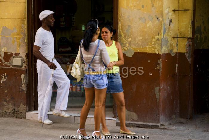 Cuba, Havana. Locals on the street, Calle Obispo, Havana