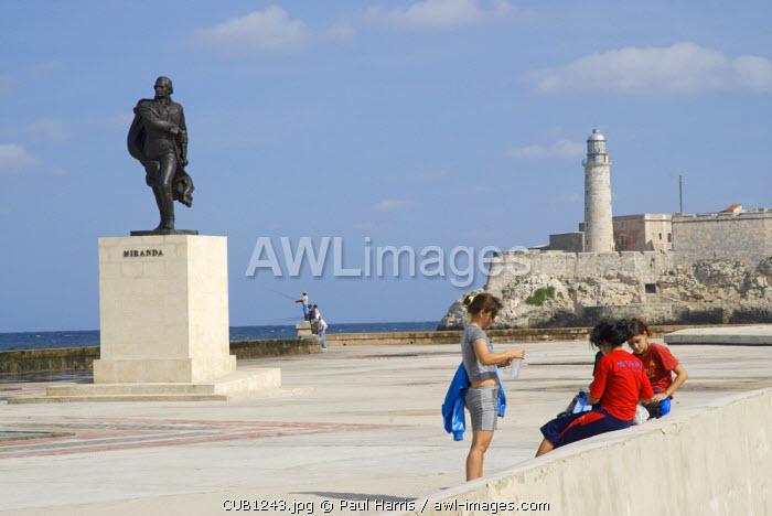 Cuba. Tourists on the Malecon, Havana