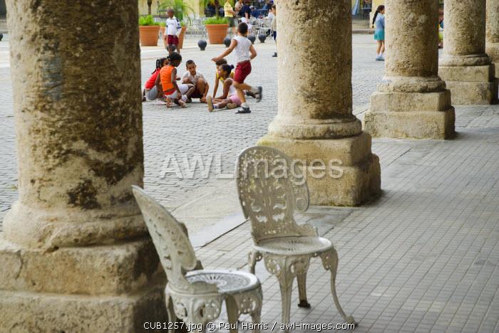 Cuba, Havana. School children playing in Plaza Vieja, Havana