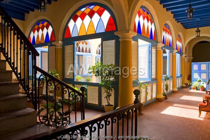 Cuba, Havana. Stained glass arches known as Virales, Casa del Marques de Aguas Claras, Plaza de la Catedral, Havana
