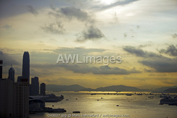 China, Hong Kong.  Looking across the urban landscape of Hong Kong Island into the Ma Wan Channel separating it from Kowloon at dusk.